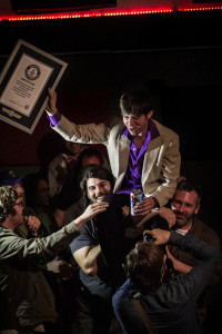 GUINNESS WORLD RECORD holder DJ Buckley, being carried around The East Room, April 15, 2015. PHOTO: Erika Chambers